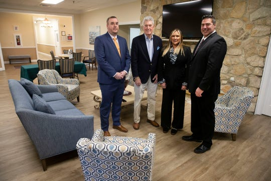 Bonnie and James Bertan (right), owners of Association Advisors NJ,  are joined by their CFO Michael Kelly (left) and Greenbriar II board president John Fahey at the developments clubhouse in Brick Monday, January 20, 2020.