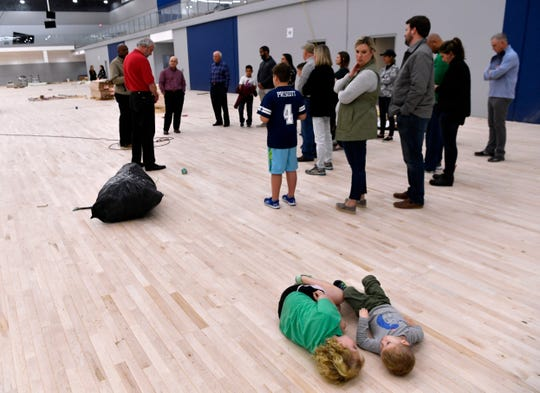 Siblings Hilary and Levi Harmon, 5 and 2, respectively, recline on the floor as their mother, Abbi, looks over at them during a tour of the Dodge Jones Youth Sports Center at Nelson Park. The $8 million project started in 2019 was one of the largest in value in Abilene.