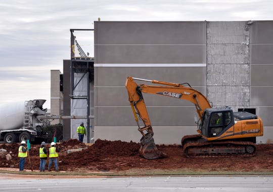An excavator works the ground around the Aldi's expansion next to Kohl's on Southwest Drive. The department store footprint was reduced providing space for the grocery store.