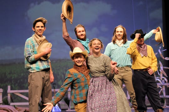 """Aunt Eller (Natalie Porer) joins Will Parker (Brent Bardin, to her right) and other cowpokes (from left, Hayden Forkner, Travis Hatch, Kyle Gilliam and Alan Mercer) in dance after Will sings about the joys of going to """"Kansas City"""" in this rehearsal scene Monday from """"Oklahoma!"""", the Abilene High School winter musical that will be staged four times Thursday-Sunday in the AHS auditorium."""