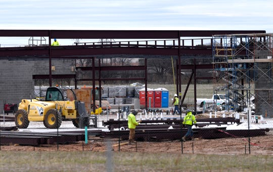 Construction workers build the framework of the new Taylor Elementary School on East North 10th Street. Taylor will be the second of three new elementary schools in the Abilene ISD but the only one to be built at a new site.