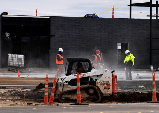Workers work at a new retail center on Jan. 21 at Ambler Avenue and North Judge Ely Boulevard as as part of the Allen Ridge mixed use lifestyle village.