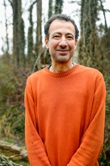 Hany Nagib poses for a portrait near the pond at ZigZag in Asheville January 13, 2020.