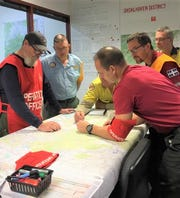 Michael Williams, second from left in blue shirt, a senior firefighter engine operator on the Nantahala National Forest, is seen here in Australia where he is assisting the country's firefighting efforts as a planning section chief.