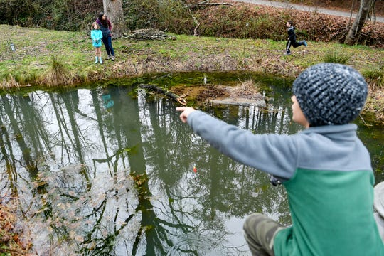 Children play and fish at ZigZag Agile Learning Community in Asheville January 13, 2020.