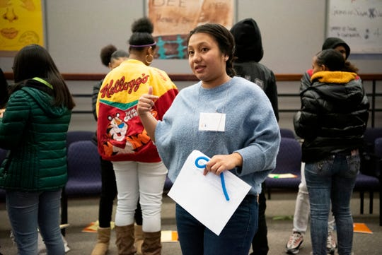 Tha Par, executive director for the Burma Center conducts a concentric circle exercise during Battle Creek's Coalition for Truth, Racial Healing and Transformation Youth Summit on Tuesday, Jan. 21, 2020 at W.K. Kellogg Foundation in Battle Creek, Mich.