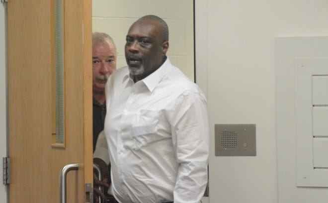 Otha Carroll enters the courtroom Tuesday to begin the trial.