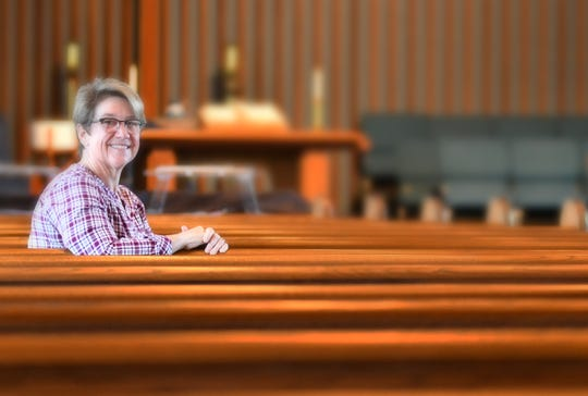 The Rev. Laura Viau, interim pastor, is pictured in the sanctuary of the First Presbyterian Church of Titusville, which will have its last service at 3 p.m. Jan. 26. The congregation at the historic North Brevard house of worship has gotten smaller and can no longer sustain the large church.
