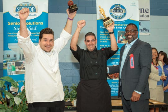 At the 2016 Best Chefs in Senior Living competition, Thomas Gurley of Palm Cottages and Manny Navarro of Market Street Residence celebrate after being presented with their trophies by former Brevard County Manager Stockton Whitten. The 2020 Chef Competition will be held during Senior Living Options Day on Jan. 31.