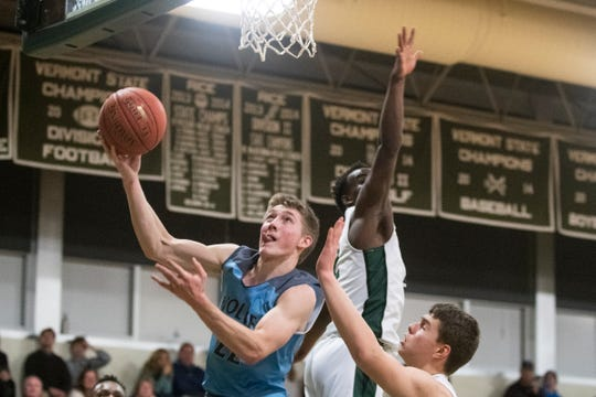South Burlington's Tyler Gammon (22) leaps for a layup during the boys basketball game between the South Burlington Wolves and the Rice Green Knights at Rice Memorial High School on Monday night January 20, 2020 in South Burlington, Vermont.