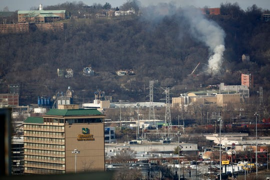 Fire crews battle a blaze in the Lower Price Hill neighborhood of Cincinnati, as seen from the Enquirer building in downtown on Tuesday, Jan. 21, 2020.