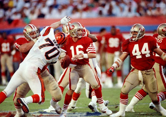 San Francisco 49ers quarterback Joe Montana prepares to fire the ball as Cincinnati Bengals' Jim Skov closes in during the first quarter of Super Bowl XXIII in Miami, Jan. 22, 1989. The 49ers won the contest 30-27 in a last-minute comeback.