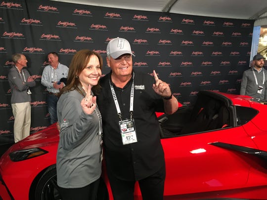 GM CEO Mary Barra and Corvette collector Rick Hendrick at the auction block where Hendrick paid $3 million for VIN 0001, the first mid-engine Corvette.