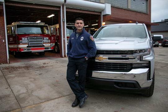 Sgt. Miles Bracali of the Ferndale Fire Department poses on Jan. 14 with his new 2020 Chevrolet Silverado. which was purchased with the help of personal dealer Brian Carroll. Carroll works with clients to find for them exactly what they are looking for in a vehicle without them having to shop on their own.