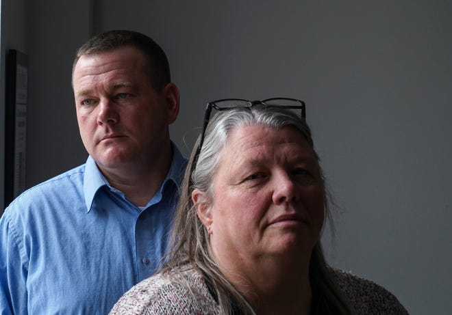 Michigan Department of Corrections resident unit managers  Brent Rohrig and Vicki McCabe pose for a photo at their attorney, Jonathan Marko's office in downtown Detroit on Friday, January 17, 2020 after talking about their loss of jobs due to trumped up internal charges. A civil service hearing determined they were wrongly retaliated against, and they got their jobs back.