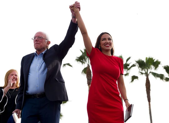Democratic presidential candidate Sen. Bernie Sanders, I-Vt., and Rep. Alexandria Ocasio-Cortez, D-N.Y., greet the crowd during a rally in Venice, Calif., Saturday, Dec. 21, 2019.