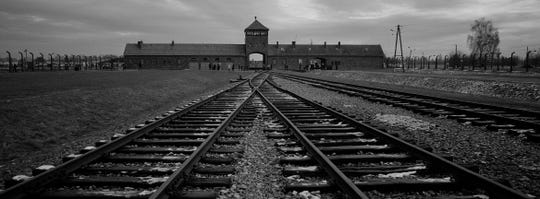 Tracks lead to the former Nazi death camp of Auschwitz in Poland. Seventy-five years after its liberation, it feels like the Jewish people are again on the verge of an anti-Semitic annihilation attempt, Coleman writes.