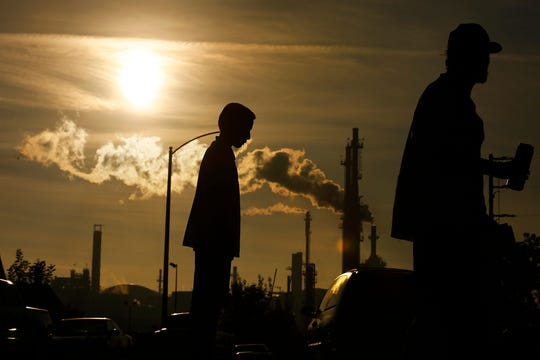 Jesse Ceja and his grandfather, Paulo Torres, stand on Emden Street in Wilmington, California, near the Phillips 66 refinery in March 2016.