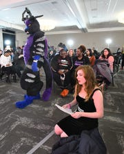 Sarah Wilke, 26, stage name Sarah Lynn, softly sings 'Put The Gun Down' by ZZ Ward, as comedian 'Serathin Sabertooth' of Green Bay, in costume, paces waiting for their turns to audition for the America's Got Talent judges at Suburban Collection Showplace in Novi, Michigan on January 21, 2020.