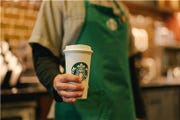 Adding whipped cream to millions of Starbucks Corp. drinks emits 50 times as much greenhouse gas as the company's private jet.