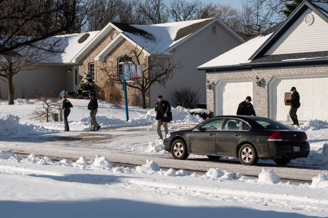 Law enforcement personnel leave the home of former U.S. Olympic women's gymnastics coach John Geddert, who had ties to disgraced sports doctor Larry Nassar, Tuesday, Jan. 21, 2020, in Grand Ledge.
