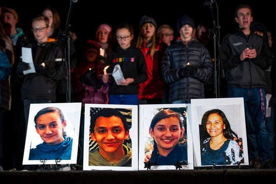 Photographs of Consuelo Alejandra Haynie, 52, right, and three of her children, 12-year-old Maylan, 14-year-old Mathew, and 15-year-old Alexis Haynie, left to right, are displayed at a candlelight vigil for the Haynie family at City Park in Grantsville, Utah, Monday, Jan. 20, 2020.