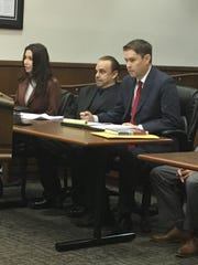 Robert Carmack appears in 33rd District Court flanked by attorneys Amelia Zelenak, left, and Todd Lanctot on Tuesday, Jan. 21, 2020.