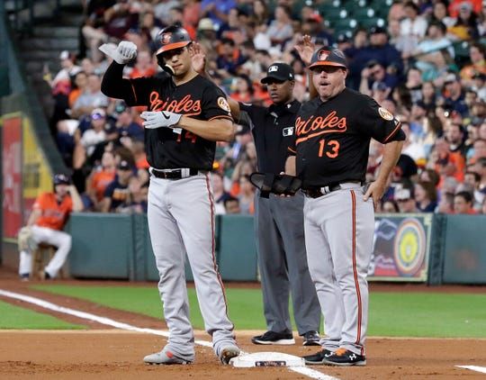 Arnie Beyeler, right, was the first-base coach for the Orioles in 2019.