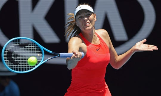 Russia's Maria Sharapova makes a forehand return to Croatia's Donna Vekic during their first-round singles match Tuesday at the Australian Open.