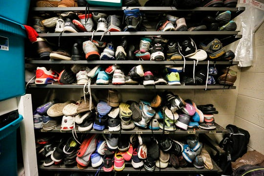 A wall of shoes in the caring closet Friday, Jan. 17, 2020, at Woodworth Middle School in Fond du Lac, Wis. The caring closet provides clothing and hygiene items that some students may need.