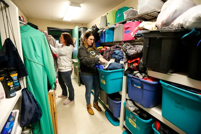 Woodworth Middle School teachers Gillian King and Nora Ballwanz arrange clothing items in the caring closet Friday, Jan. 17, 2020, at Woodworth Middle School in Fond du Lac, Wis. The caring closet provides clothing and hygiene items that some students may need.