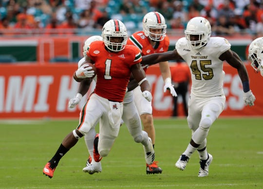 Miami running back Lorenzo Lingard (1) runs during the second half of a game against FIU on Saturday, Sept. 22, 2018, in Miami Gardens, Fla. Lingard will be playing with the Florida Gators in the 2020 season.