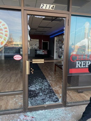 A distraut man smashed the glass door at Tesla's Cellular Repair on Sunday, entered the buisness and bowed to a military recruitment poster