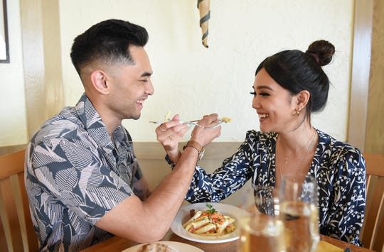 Michelle Dulana and Adam Suharto feed each other some Penne alla Primavera Italian pasta during a dinner at Prego in The Westin Resort Guam, Tumon, Jan. 20, 2020.