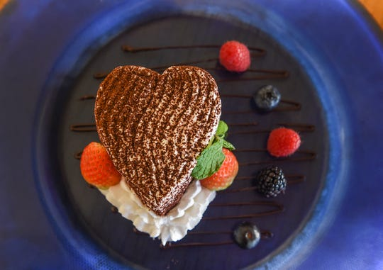 Prego's Valentine's Day dessert, a heart-shaped tiramisu cake and berries is served at Prego in The Westin Resort Guam, Tumon, Jan. 20, 2020.