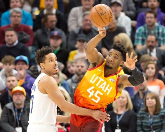 Jan 20, 2020; Salt Lake City, Utah, USA; Utah Jazz guard Donovan Mitchell (45) passes the ball against Indiana Pacers guard Malcolm Brogdon (7) during the first quarter at Vivint Smart Home Arena.