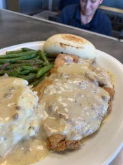 Beyond the burgers, the specials – loaded with homemade gravy – are popular.