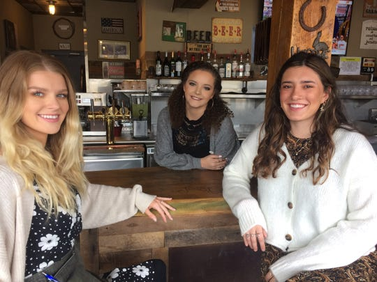 Making the front of The Burgers on Emory run smoothly in this January 2020 photo are general manager Alex Jones (right), assistant manager Brittany Hurst (center) and server Delaney Ailor.
