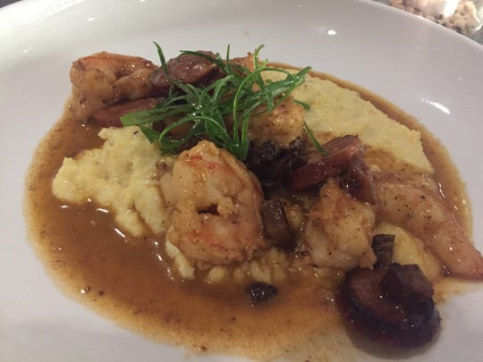 Knox Mason's shrimp and grits feature Shelton Farm grits and jumbo shrimp, ham and smoked sausage.