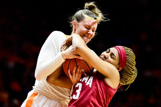 Tennessee forward Lou Brown (21) and Alabama guard Brittany Davis (23) battle for possession of the ball during a game between Tennessee and Alabama at Thompson-Boling Arena in Knoxville, Tennessee on Monday, January 20, 2020.