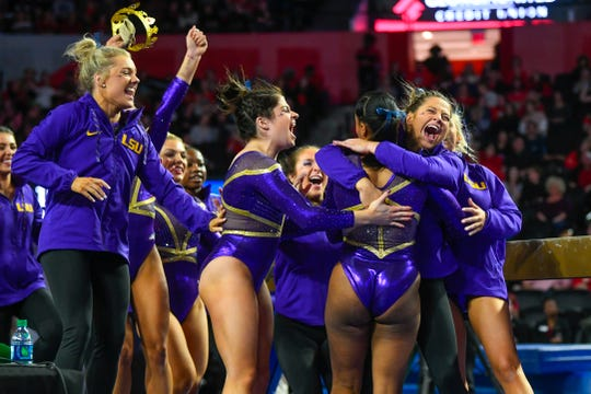 LSU gymnasts celebrate after a routine against Georgia during an NCAA gymnastics meet on Friday, Jan 10, 2020 in Athens, Ga. LSU won the meet. (AP Photo/John Amis)
