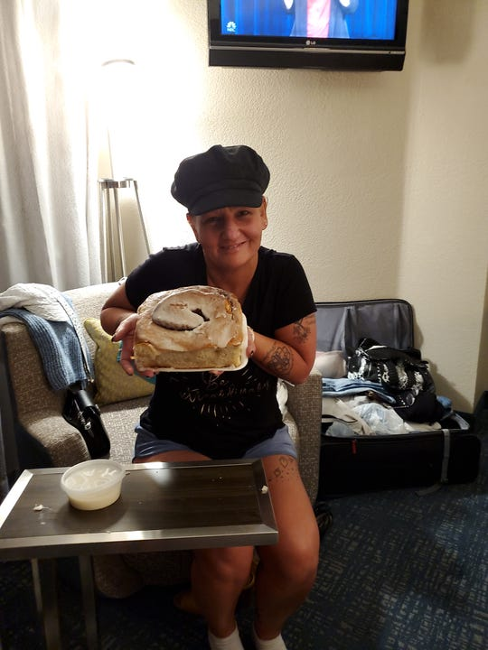 One of cancer survivor Catt Pryde's bucket list items was to get a 3-pound cinnamon roll from Lulu's Bakery & Café in San Antonio, Texas.