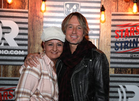 Meeting country musician Keith Urban was on Hamburg Township employee Catt Pryde's bucket list, which helps her stay positive while living with terminal cancer. She met him backstage at the Fox Theatre in Detroit before a Nov. 6, 2019 concert.