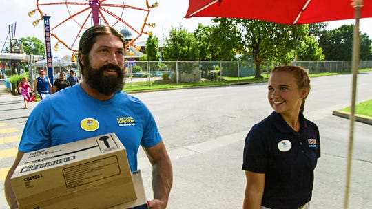 """Dippin' Dots CEO Scott Fischer (left) will be featured in an """"Undercover Boss"""" episode on Wednesday, Jan. 22, 2020, at Kentucky Kingdom in Louisville, where his company's frozen treats are popular with visitors. Fischer was trained and supervised by Bailey Richardson (right), Kentucky Kingdom's food and beverage supervisor."""