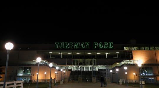 Patrons enter Turfway Park on a Thursday night. Turfway has recently been bought but Churchill Downs and is planning a $100 million makeover.