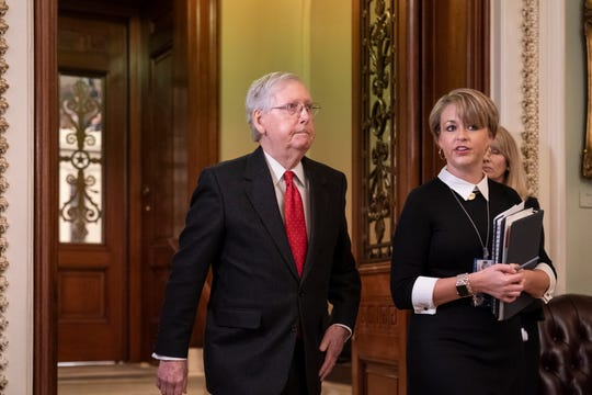 Senate Majority Leader Mitch McConnell, R-Ky., steps out of the chamber during the start of the impeachment trial of President Donald Trump on charges of abuse of power and obstruction of Congress, at the Capitol in Washington, Tuesday, Jan. 21, 2020. (AP Photo/J. Scott Applewhite)