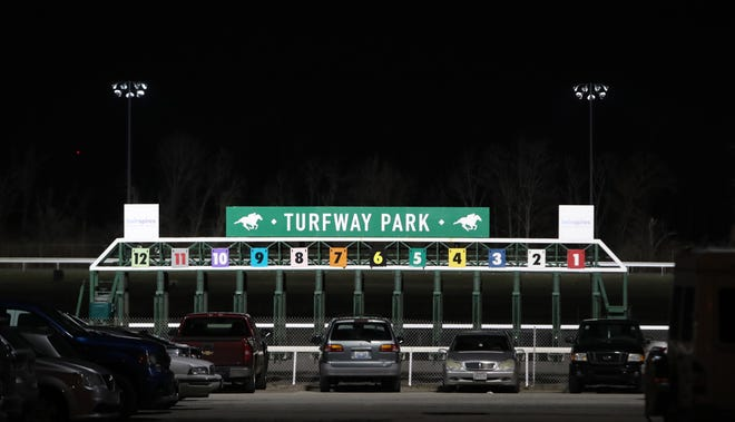 The starting gate at Turfway Park is moved between races on a Thursday night. Turfway has recently been bought but Churchill Downs and is planning a $100 million makeover. Dec. 19, 2019