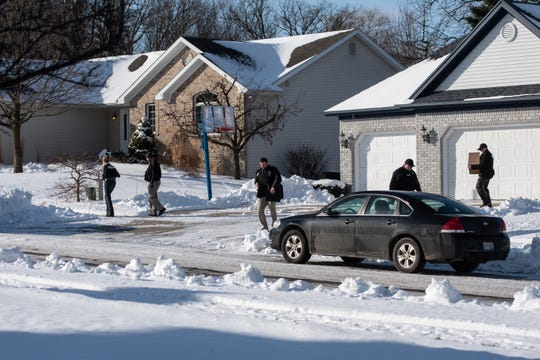 Police leave the home of former U.S. Olympic women's gymnastics coach John Geddert in Grand Ledge, Michigan, late Tuesday morning, Jan. 21, 2020, with a box.