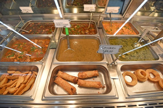 A variety of favorite Indian dishes can be found in the hot food selection at KV Market.