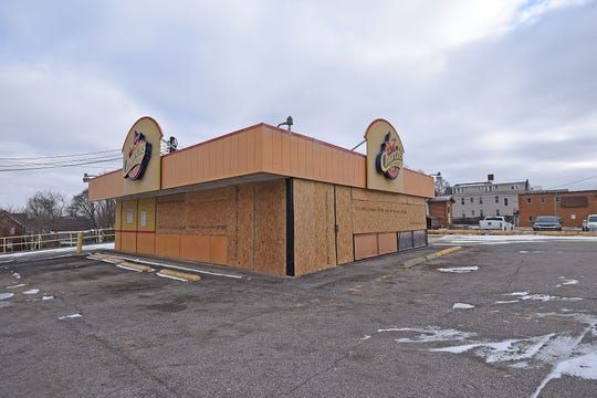 Church's Chicken, on the corner of Park Avenue West and North Benton Street, is boarded up and recently closed.